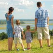 Happy family on top of hill — Stock Photo #55388949