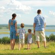 Happy family on top of hill — Stock Photo #55388955