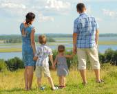 Happy family on top of hill — Stock Photo
