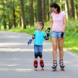 Mother and son learn roller skating — Stock Photo #55397169