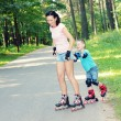 Mother and son learn roller skating — Stock Photo #55397177