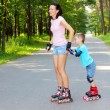 Mother and son learn roller skating — Stock Photo #55397193