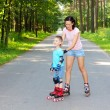 Mother and son learn roller skating — Stock Photo #55397305