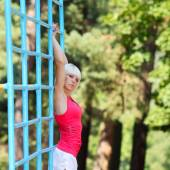 Beautiful fitness woman doing exercise — Stock Photo