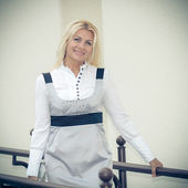 Senior business woman in city — Stock Photo