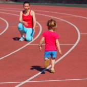 Mother and daughter exercising at stadium — Stock Photo