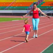 Mother and daughter exercising at stadium — 图库照片