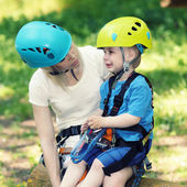 Little boy in climbing outfit crying — Stock Photo