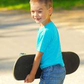 Little boy with skateboard — Stock Photo