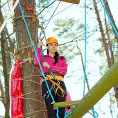 Girl having fun in adventure park — Stock Photo