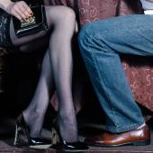 Closeup of male and female legs during a date — Stock Photo