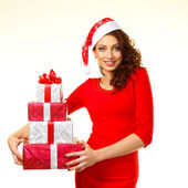Woman in santa hat with gift box — Stock Photo