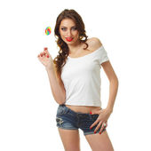 Brunette woman  holding a lollipop — Stock Photo