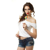 Brunette woman  holding a lollipop — Stock Photo