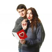 Couple having fun with a paper heart — Stock Photo