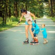 Family having fun on roller skates — Stock Photo #66765961