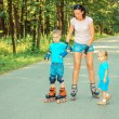 Family having fun on roller skates — Stock Photo #66765979