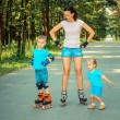 Family having fun on roller skates — Stock Photo #66765989