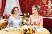 Retro dressed girls in restaurant — Foto de Stock