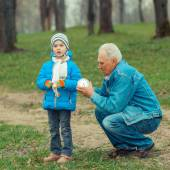 Grandfather showing grandson vintage watches — Stock Photo