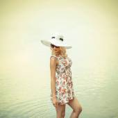 Girl in hat in sunglasses on beach — Stock Photo