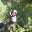 Постер, плакат: Boy at adventure park