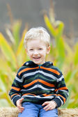 Kid at pumpkin patch — Stock Photo