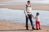 Family at californian beach — Stock Photo