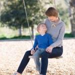 Family at swings — Stock Photo #63391717