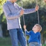 Family at swings — Stock Photo #63391735