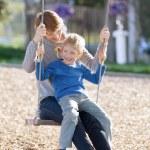 Family at swings — Stock Photo #63391787