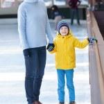 Family ice skating — Stock Photo #79096042