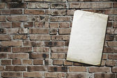 Paper on brickwall — Stock Photo