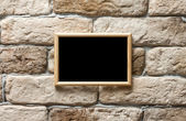Photo frame on wall — Stock Photo