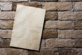 Old paper on wall — Stock Photo