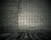 Room with brick wall — Stock Photo
