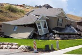 Ruined by landslide house — Stock Photo