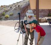 Boy looking at the sunspots in the solar telescope — Stock Photo