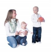 Mom with a little girl in her arms, looking at her son and daugh — Stock Photo