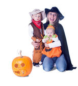 Mom with two kids in costume and pumpkin — Stock Photo