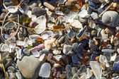 Ocean polished glass shards and stones — 图库照片
