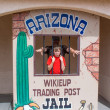 Father and son in  cartoon Arizona jail — Stock Photo #71175855