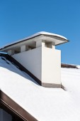 Chimney on snowy roof — Stock Photo