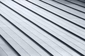 Diagonal corrugated metal gray rooftop surface — Stock Photo