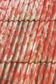 Red painted asbestos roof — Zdjęcie stockowe