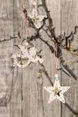 Christmas star and angel hanging over old wooden board — Stock Photo