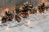 Christmas lights with pine cones — Stock Photo