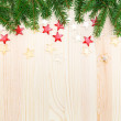 Christmas wooden background with fir tree and stars — Stock Photo #57889225