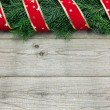 Christmas background with fir tree and ribbon on wood — Stock Photo #58214545