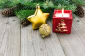 Christmas candle with fir twig and bauble on the desk — Stock Photo